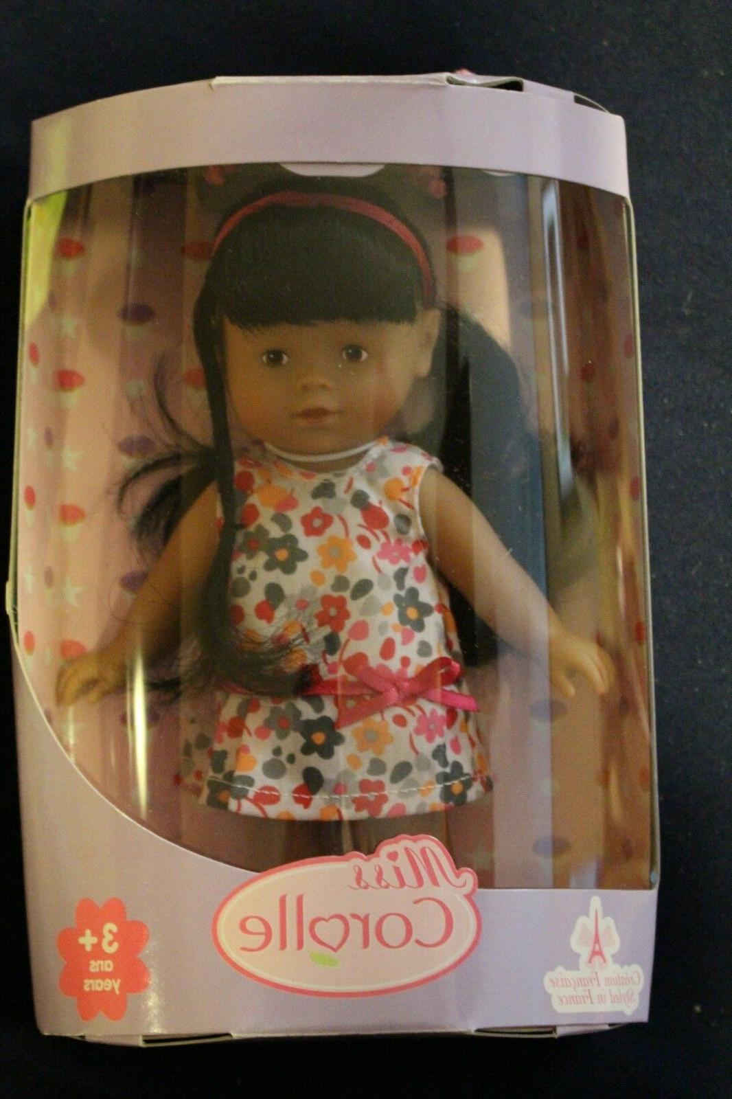 miss 8 inch baby doll with flower