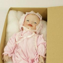 The Ashton-Drake Galleries Porcelain Baby Doll Yolanda Bello